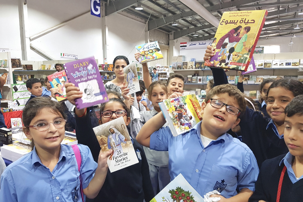 Children with Scriptures at the Amman book fair.